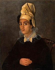A Creole woman wearing a tignon.